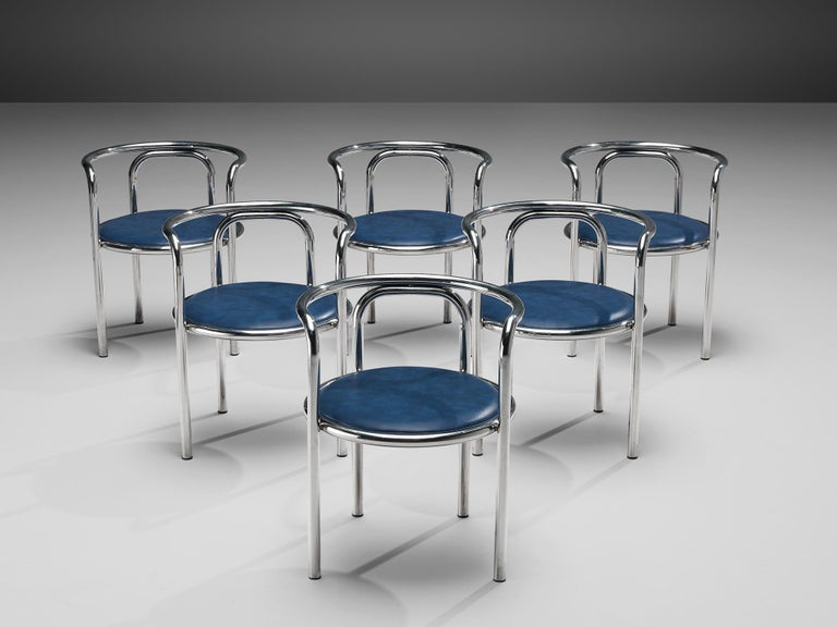 Gae Aulenti for Zanotta, 'Locus Solus' armchairs, chromed tubular steel, blue leatherette, Italy, 1964  Set of 'Locus Solus' armchairs. These armchairs, designed by Gae Aulenti and produced by Poltronova, are one of Aulenti's most playful design