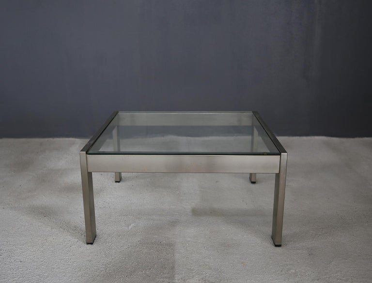 Gae Aulenti coffee table for the Rinascente shop Milan, 1970s. The coffee table is part of the TAU series exclusively for the La Rinascente department store in Milan. It is made of chrome-plated steel and its top is made of glass. Inside the table