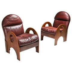 """Gae Aulenti Pair of """"Arcata"""" Easy Chairs in Walnut and Burgundy Leather"""