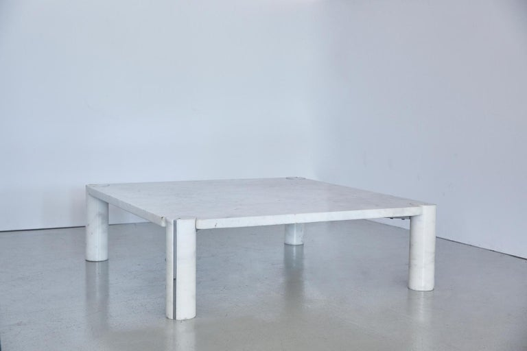 Stunning Gae Aulenti style low coffee table in white Carrara marble and chrome detail on pillar legs. Excellent design and in great vintage condition.