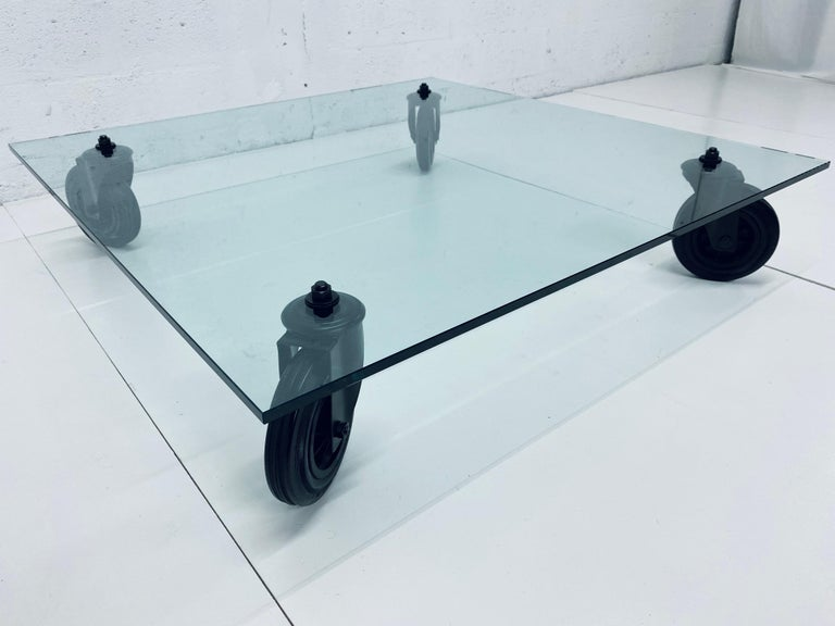 Industrial Gae Aulenti Tavolo Con Ruote Low Glass Coffee Table on Casters for Fontana Arte For Sale