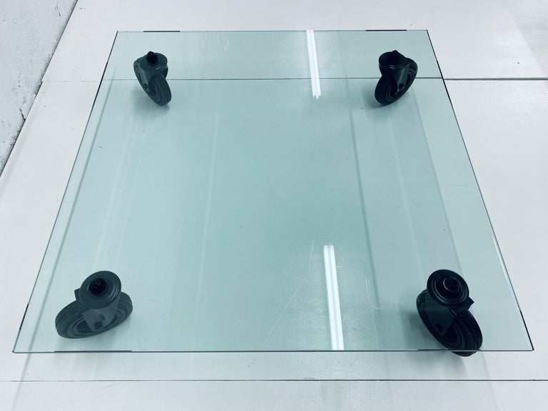 Contemporary Gae Aulenti Tavolo Con Ruote Low Glass Coffee Table on Casters for Fontana Arte For Sale