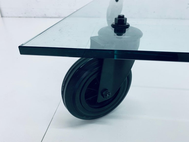 Steel Gae Aulenti Tavolo Con Ruote Low Glass Coffee Table on Casters for Fontana Arte For Sale