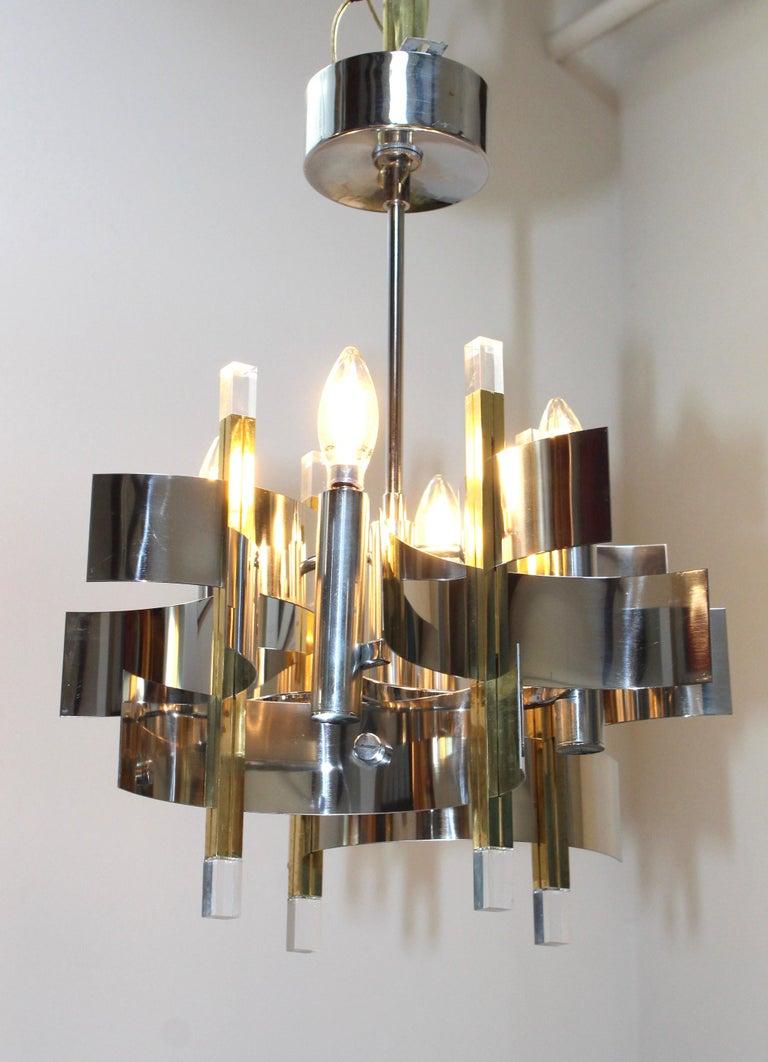 1970s Mid-Century Modern Gaetano Sciolari brass, chrome and Lucite petite chandelier.