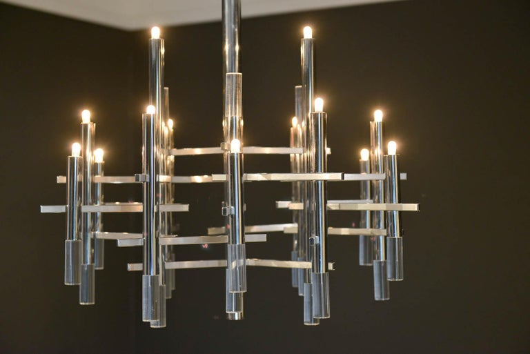 Gaetano Sciolari chrome and Lucite chandelier, circa 1970. Sculptural modern chandelier designed by Gaetano Sciolari in Italy, circa 1970s. This elegant chandelier features twelve chrome and Lucite vertical cylinders, nine of which hold the
