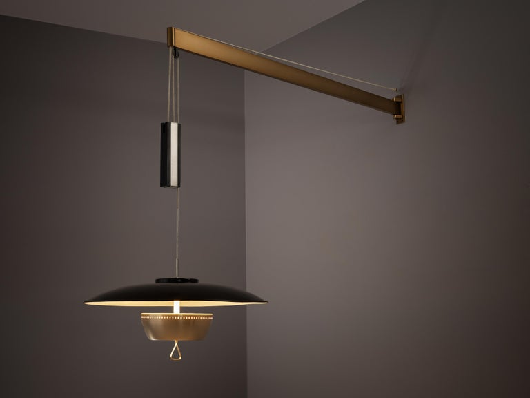 Gaetano Sciolari for Stilnovo, wall lamp model 1244, aluminum, brass, Italy, circa 1950  Elegant and modern wall-mounted pendant with a black coated shade by Sciolari. Adjustable in height due the counterweight that hangs on a horizontal brass