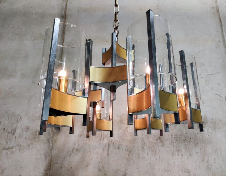 Beautiful 'hurricane' chandelier by Gaetano Sciolari with 6 lightpoints/glasses  Stunning timeless design that emits a beautiful light.  It can be used with regular E14 candle light bulbs.  1970s - Italy  tested and ready to use.  Dimensions: Height