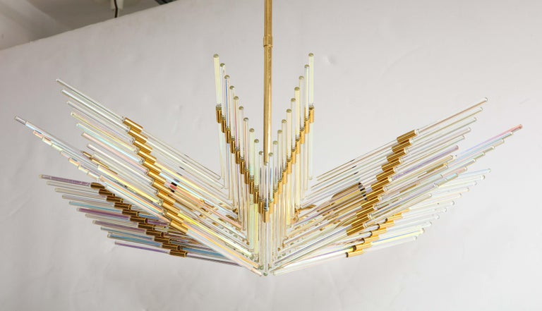 A Gaetano Sciolari iridescent and gold plated chandelier. The 'wings' of the chandelier emanate from a central gold plated stem, with iridescent glass rods inserted into individual gold plated rings. A very unique piece, which would make for a
