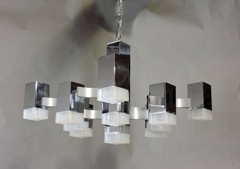 Beautiful Mid-Century Modern Cubic chandelier designed by Gaetano Sciolari and made in Italy for Lightolier. This chandelier consists of thirteen rectangular polished chrome cubes with Lucite shades. The hanging chain is three feet, and the original