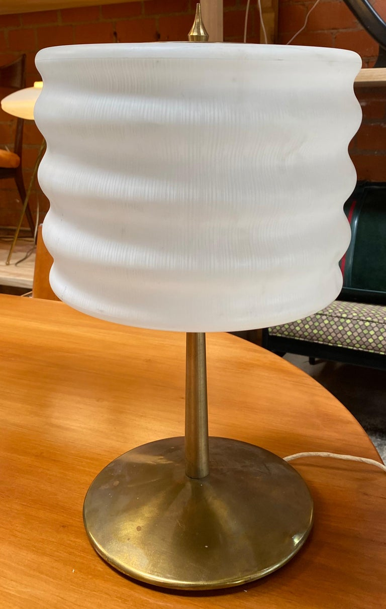 A brass and glass table lamp designed and manufactured by Gaetano Sciolari, name impressed on the bottom. Brass and glass in original patina, circa 1970.