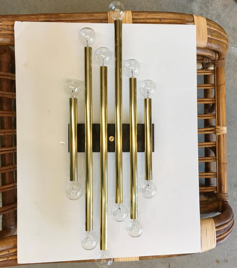 Gaetano Sciolari designed the Tubular Collection for Lightolier in the 1960s. Here we present model 4686 multi-tubular brass wall sconce designed by Gaetano Sciolari and produced by Lightolier in 1966. Original label present. See detail images from