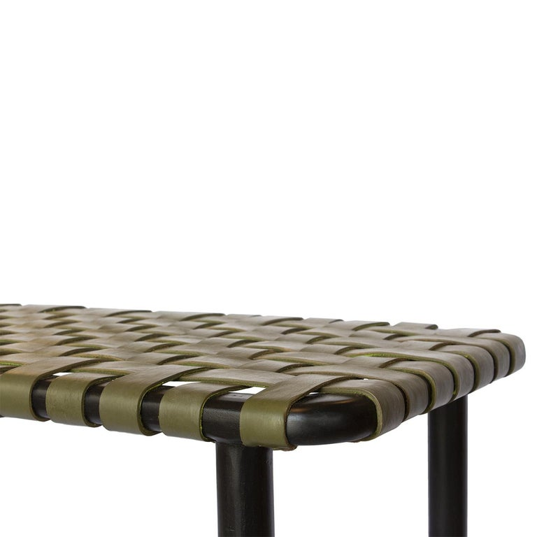 Linear, elegant lines define the sleek aesthetic of this bench whose sturdy structure is fashioned of solid, black-finished teak and deftly shaped by master artisans. The rectangular seat offers great support and unparlleled comfort thanks the