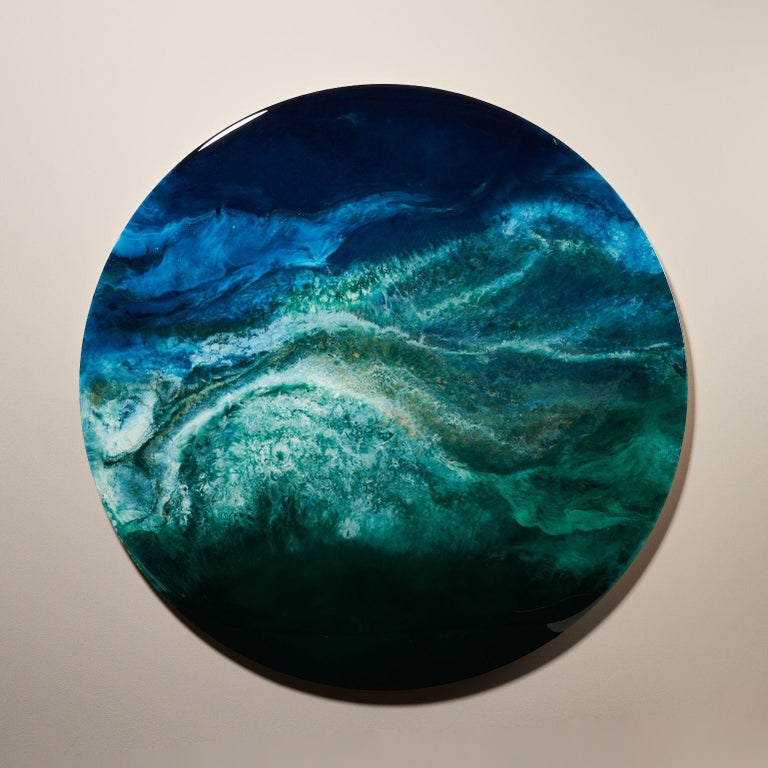 Gaia's Iris concept minimalistic round by Corine Vanvoorbergen Dimensions: diameter 150 cm Materials: Brass, wood, natural pigments, epoxy and acrylics   Corine van Voorbergen is an intuitive artist. Through her minimalistic round art forms she