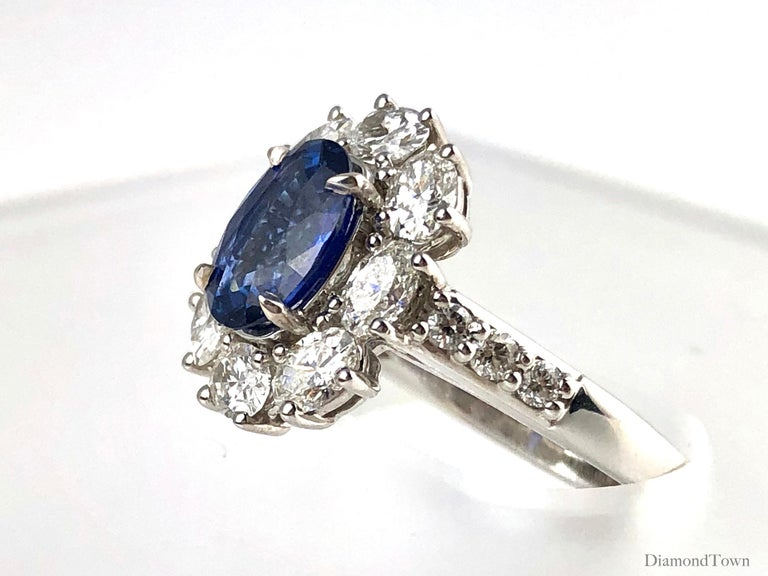 Contemporary GIA Certified 1.89 Carat Oval Cut Ceylon Sapphire and Diamond Cluster Ring For Sale