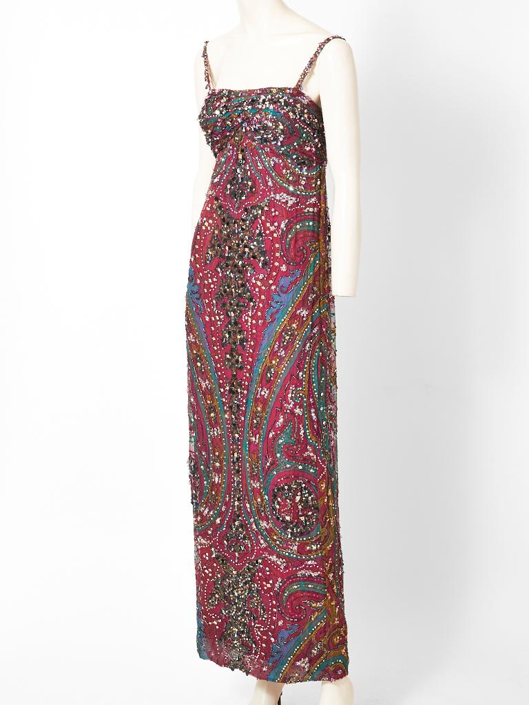 Galanos, paisley pattern,  empire waist  chiffon gown, embellished with beads and sequins, having a slim body with spaghetti straps. The outer layer of the dress has a paisley pattern in a silk chiffon. The underpinning is a silk charmeuse in the