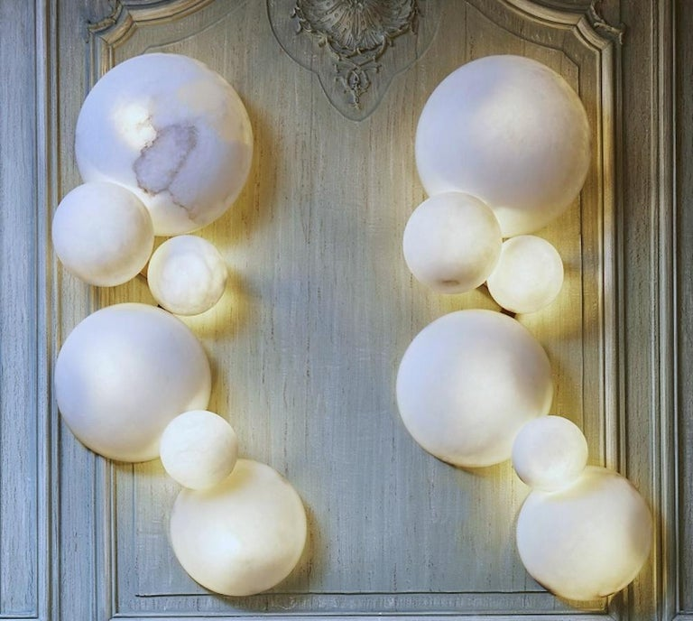 Striking contemporary Italian alabaster marble globe sconces or wall lights. Exclusive production of Tuscany alabaster, handmade with great skill of Italian craftsmanship.
