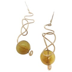 Galaxy Earrings with hand-blown amber glass by Sidney Cherie Studio