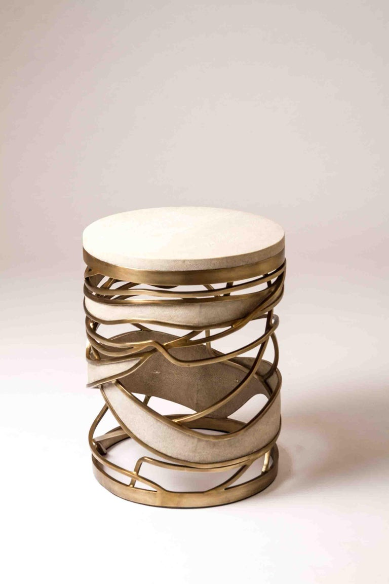 The sculptural and airy Galaxy side table or stool can be used both ways. This is a dramatic piece that showcases the incredible craftsmanship of Kifu Paris. This piece is designed by Kifu Augousti, the daughter of Ria and Yiouri Augousti.  The