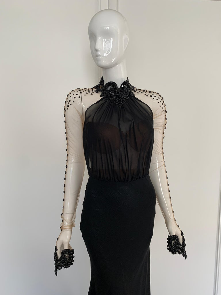 A Gaila Lahav Black and Sheer stunning gown. Amazing beaded neck and wrists with detailed beading over nude sheer on the arms and down the back.   You can tell the dress is Haute Couture, no detail is spared. The skirt is two layers of black silk,
