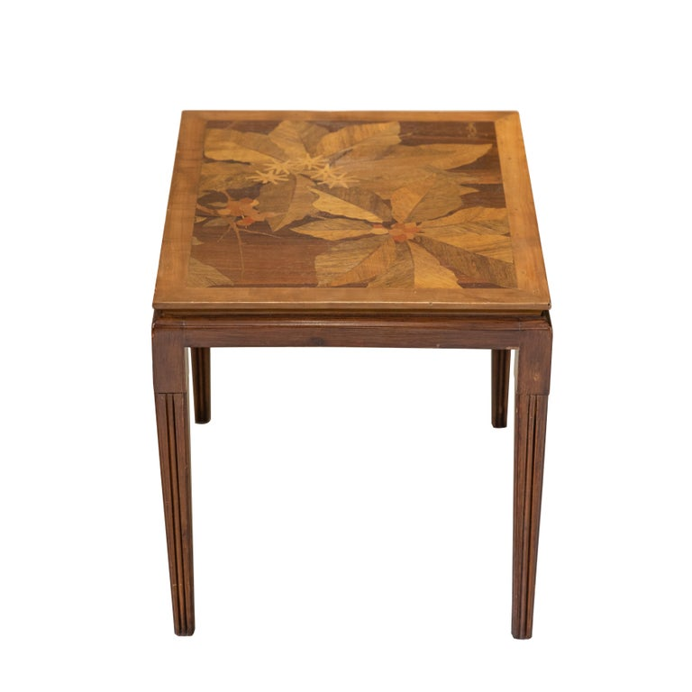 Emile Gallé inlaid early 20th century art nouveau side table with floral and foliage motifs. French designer Emile Gallé is considered to be one of the driving forces behind the Art Nouveau movement. His artwork lives on in almost every museum