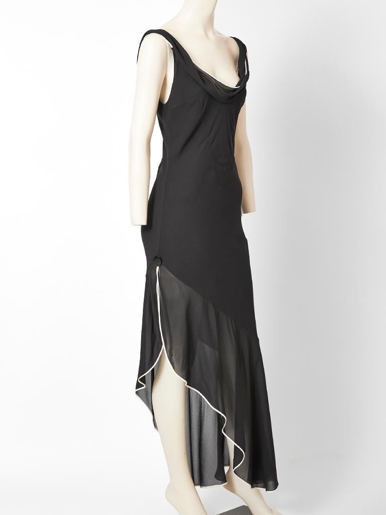 John Galliano for Dior, black, silk georgette, bias cut cocktail dress with a deep front and back neckline. Dress is lined in a nude tone georgette having an attached sheer bias cut, asymmetric flounce that starts at the thigh. Flounce has a white