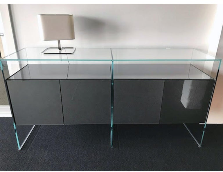 """Modular system of wooden elements covered by painted glass. Inside it's 16 inches high and 8 inches to the shelf **note mismatched doors. Measures: 72"""" W x 36"""" H x 20"""" D."""