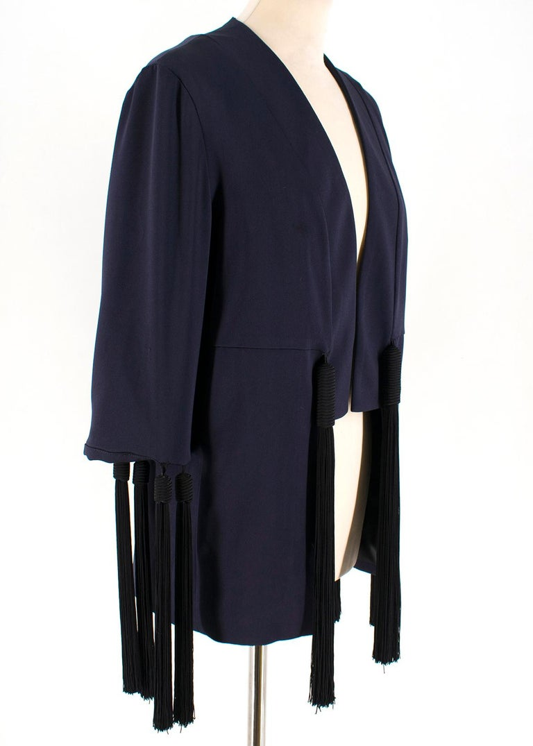 Galvan fringe navy blue jacket   Open jacket with no closure lining 97% polyester 3% elastane; 12 black fringe application; Made in England   approx Measurements are taken laying flat, seam to seam.  shoulders 40 cm sleeve length 40 cm chest 50