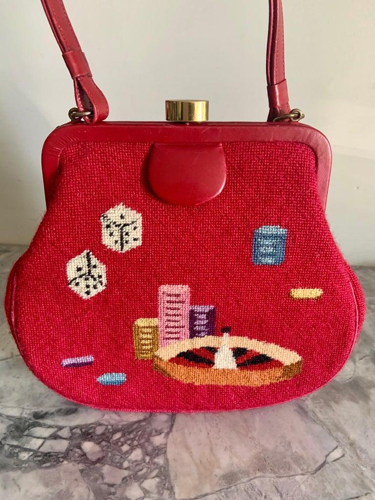This tiny bag is perfect for the gambler!  It would look chic and be a fun accessory in Monte Carlo, Las Vegas, Atlantic City or at the local bingo game. This bag is a small version of the popular needlepoint bags from the 1950's.  It is trimmed in