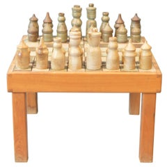 Game of Chess with His Table
