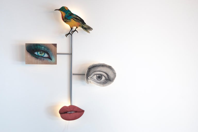 This sculptural wall light from Mattia Biagi's Metropolitan sets series expresses the personal investigation of the artist straddling life and death, nature and civilization, preservation and transformation. The images used to build the bodies of
