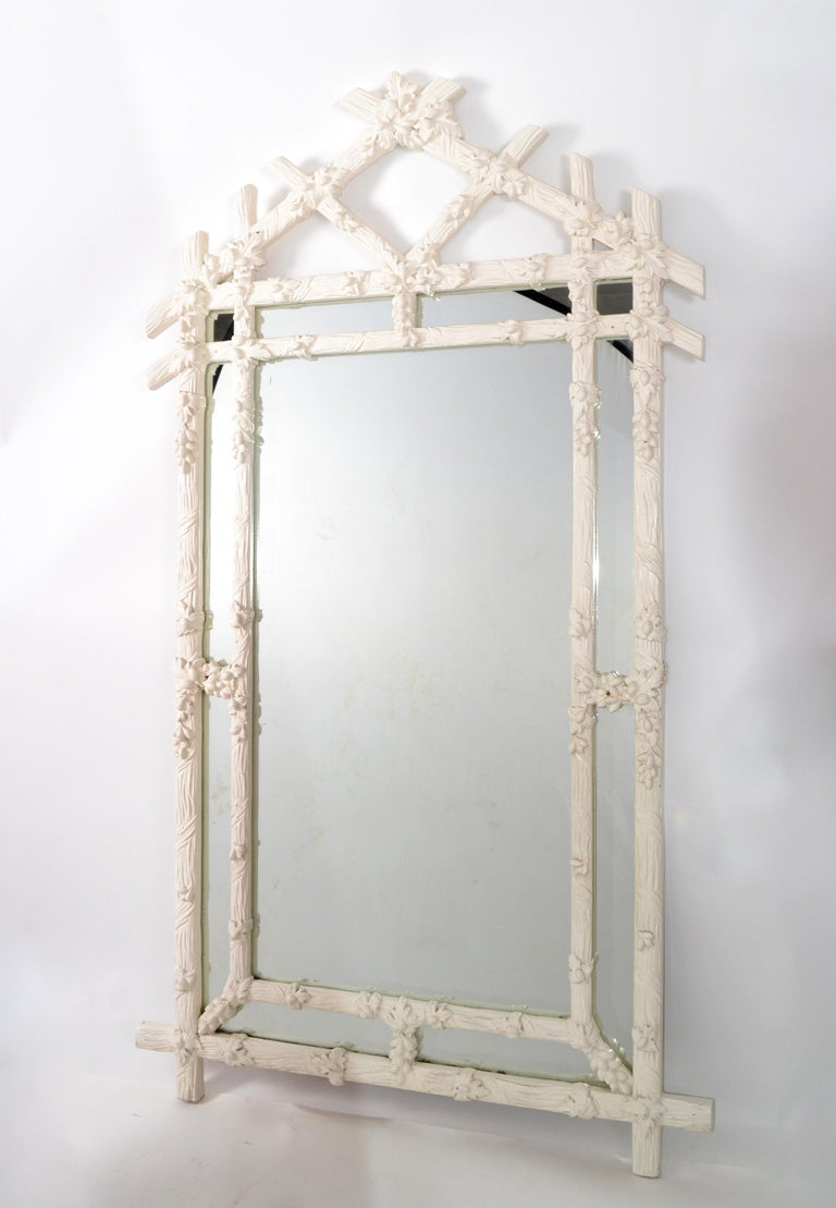 1970s Hollywood Regency Faux-Bois antique white hand carved wood wall mirror made in Italy for Gampel-Stoll. Heavy Gothic style shape and it can be securely hung. In original very good vintage condition. Mirror size: 27 x 46 inches.