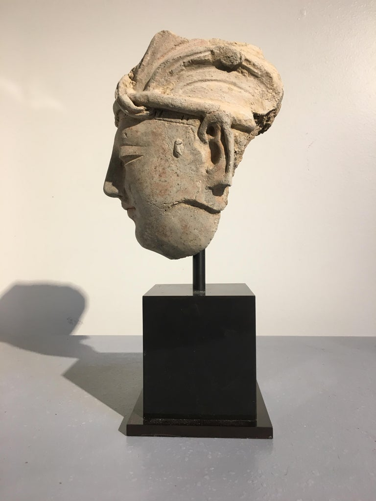 Hand-Crafted Gandharan Stucco Head of a Donor, 4th-5th Century For Sale