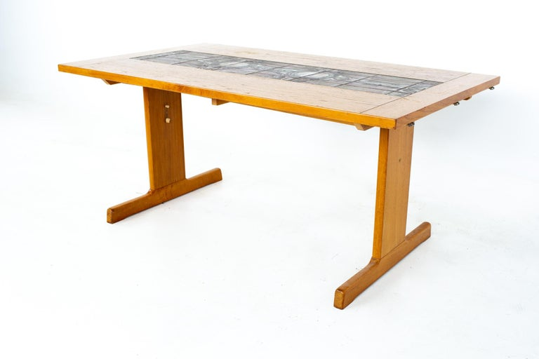 Gangso Mobler mid century teak tile top dropside dining table Table measures: 62.5 wide x 36 deep x 28.5 inches high; each leaf is 18 inches wide, making maximum table width of 98.5 inches when both leaves are used   All pieces of furniture can