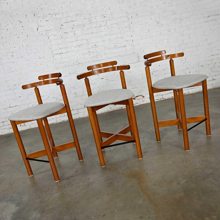 Handsome set of 3 Gangso Mobler Scandinavian Modern counter height barstools comprised of teak frames and new gray linen-look/tweed upholstery. Beautiful condition, keeping in mind that these are vintage and not new so will have signs of use and