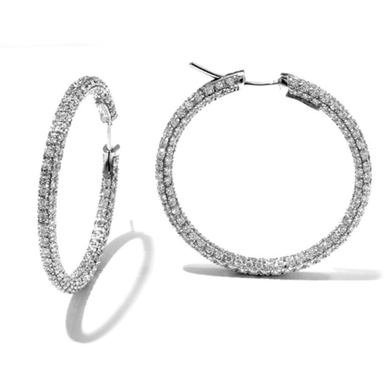 Garavelli 18 Karat White Gold Diamond Eternity Hoop Earrings The traditional and classic pavé diamond hoops. Where you don't see that diamonds. Internal diameter mm 33 18KT GOLD  gr: 14 WHITE DIAMONDS ct : 7.65