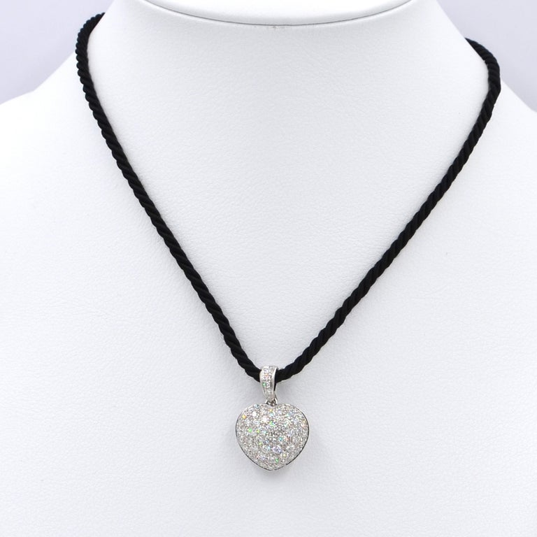 Garavelli  18 Karat White Gold Pavè Diamond Puffed Heart Pendant  The Heart featurs a very nice pavè cushion of white diamonds of different sizes, degrading from a center large stone to the sides;  size mm 20x22 including the openable diamond bale