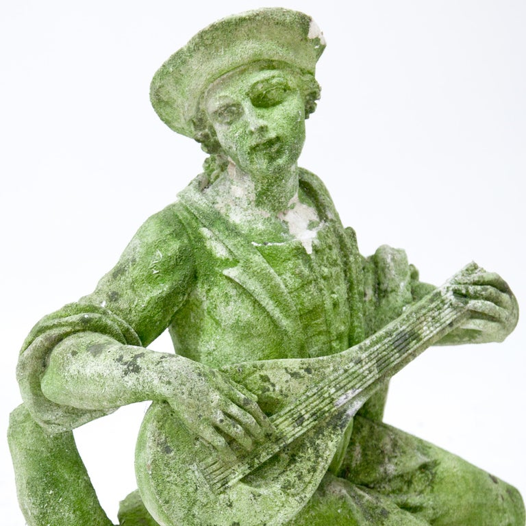 Italian Pastoral sculpture in carved Pietra di Vicenza stone of a seated lute player with a dog at his feet. Very detailed carving, partly damaged and weathered. Provenance: England.