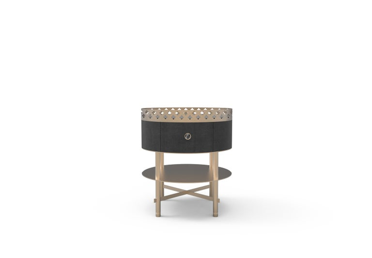 Round side table composed by a wooden compartment with drawer, top shelf in metal, lower shelf in metal. Laser-cut interlocking tubular structure in metal and laser-cut metal sheet with flower motifs finished manually.
