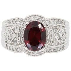 Garnet and Diamond Filigree Ring in 14 Karat White Gold