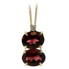 Garnet and Diamond Pendant Necklace, Mounted in 18 Karat Yellow Gold