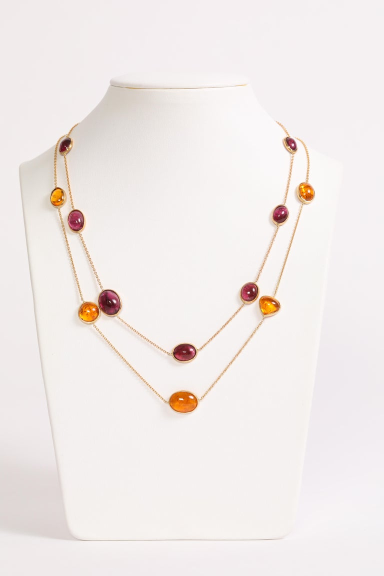 A beautiful harmony of colours for these two charming necklaces. One is made of seven hessonite garnet cabochons set on 18K yellow gold chain. The second one is made of eight pink tourmaline cabochons set on 18K pink gold chain. Hessonite garnet