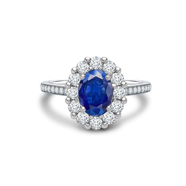 A House of Garrard platinum ring from the 1735 collection set with a central GIA certified oval blue sapphire weighing 1.33 carats and 34 round white diamonds weighing 0.62 carats Size: 52 / 6 (Ring can be sized up or down; by two sizes) 1 oval
