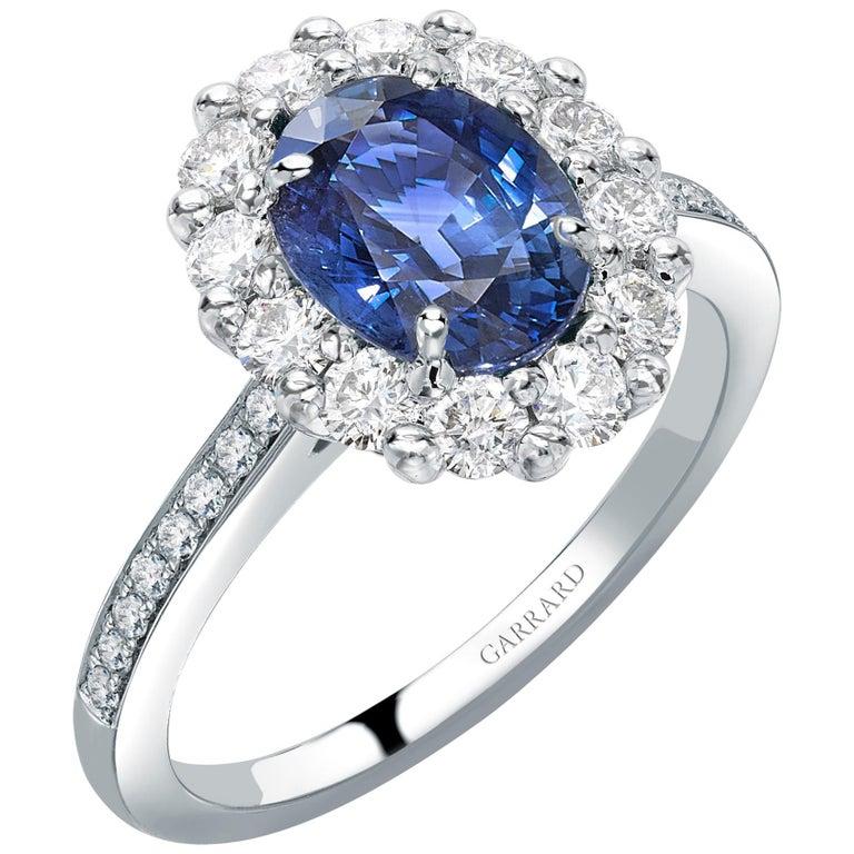 Garrard 1735 Platinum GIA Oval Blue Sapphire Diamond Cluster Engagement Ring For Sale