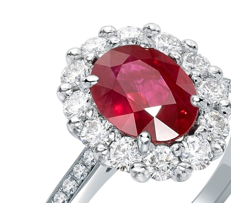 A House of Garrard platinum ring from the 1735 collection set with a central GIA certified oval ruby weighing 1.63 carats and 34 round white diamonds weighing 0.60 carats Size: 53 / 6.5 (Ring can be sized up or down; by two sizes) 1 oval ruby