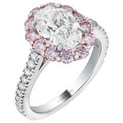 Garrard '1735' Platinum GIA Oval White Diamond with Pink Diamond Surround Ring