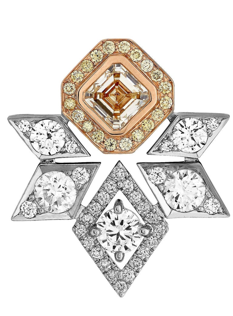 A pair of 18 karat white and yellow gold stud earrings from the House of Garrard. The earrings are set with 2 GIA Asscher cut diamonds weighing 2.02 carats, 66 round white diamonds weighing 2.61 carats and 40 round yellow diamonds weighing 0.30