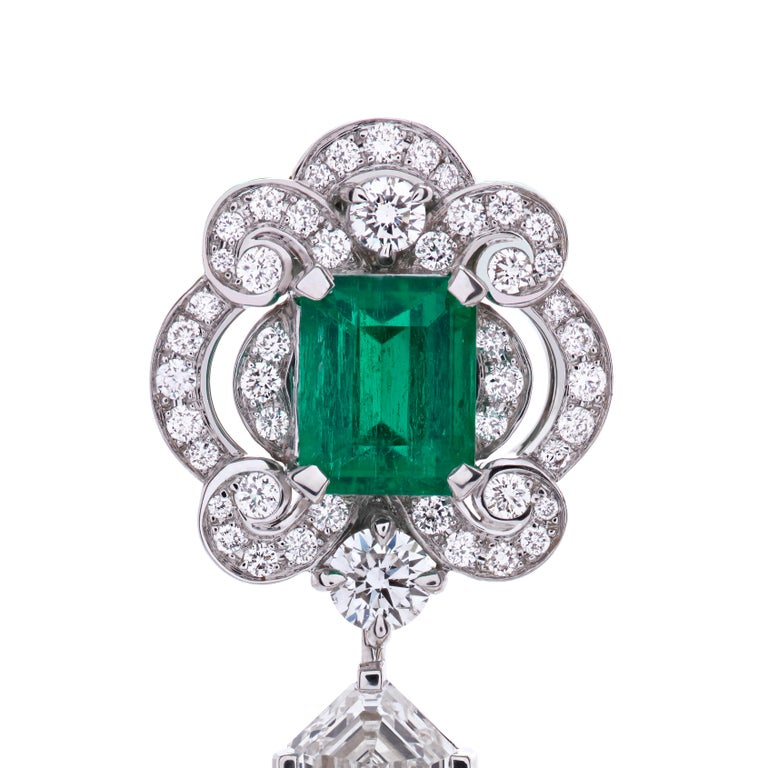 A pair of 18 karat white gold earrings from the House of Garrard. The earrings are set with central Gubelin certified emerald cut emeralds weighing 1.61 carat and 1.67 carat, GRS certified pearshape emeralds weighing 1.42 carat and 1.51 carat and 46