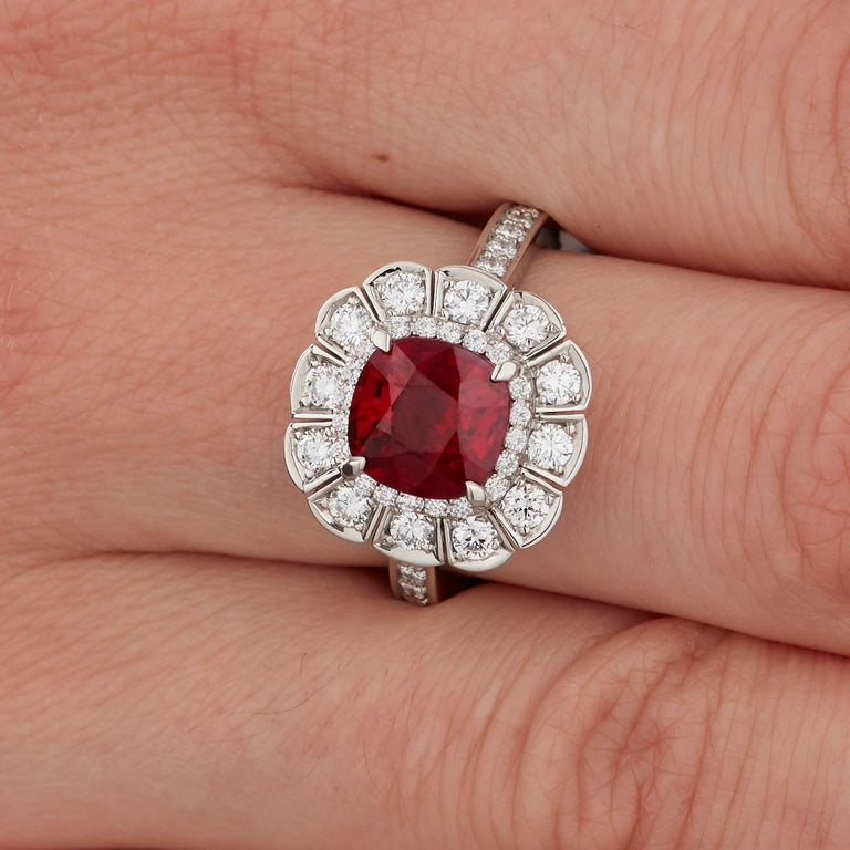 A House of Garrard white gold ring from the Jewelled Vault collection, set with a central GRS certified cushion 3.04 carat vivid red ruby and 48 round white diamonds weighing 2.15 carats.  Ring size 54 is accompanied by GRS certificate and House of