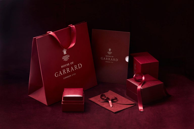 Garrard 'Bow' 18 Karat White Gold Round and Emerald Cut White Diamond Earrings 5