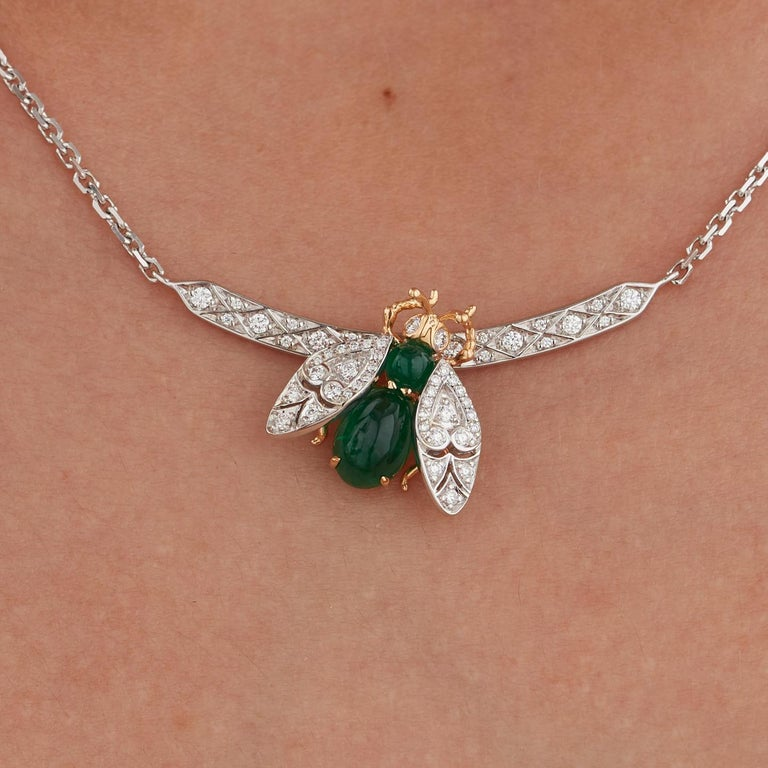 A House of Garrard 19 Karat white gold pendant from the Enchanted Palace collection. A Fly motif set with cabochon Emerald body and diamond pave set eyes and moving/articulating wings with 18 karat yellow gold head, legs and under-body. The fly is